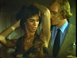 Richard Harris and Ann Turkel in 99 and 44/100% Dead